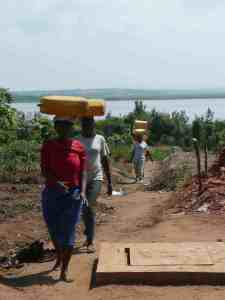 Rwanda women carrying water until well installed