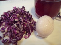 The red cabbage is a tricky one. While it appeared to have barely worked after sitting in the solution for several hours, after the egg came out of the dye and sat in the refrigerator over night, it became a BEAUTIFUL Robin's Egg blue! A complete surprise to say the least! I used about 1/4 of a red cabbage, chopped very fine (1-2 cups), 1 cup boiling water and 1 tablespoon vinegar.